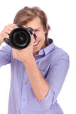 Young man with photo camera Stock Photo