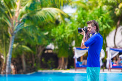 Young man photographing landscape on a tropical Stock Photo