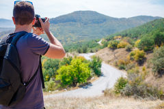 Young man photographing mountain Royalty Free Stock Images