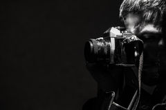 The young man photographs a retro old camera Black and white photo. Royalty Free Stock Photography