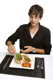 Young man picking up a taco Royalty Free Stock Photos