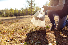 Young man picking up trash Royalty Free Stock Images