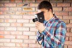 Young Man Picture Using Vintage Camera Royalty Free Stock Photos