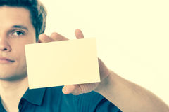 Young man with piece of paper. Stock Images