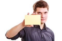Young man with piece of paper. Royalty Free Stock Photos