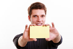 Young man with piece of paper. Royalty Free Stock Photography