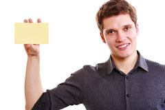 Young man with piece of paper. Royalty Free Stock Images