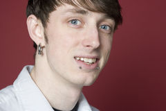 Young man with pierced face. Portrait of a young man with pierced ears and lips Stock Image