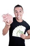Young man piggy bank and bills. On white background Stock Photos