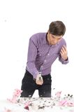 Young man with piggy bank and hammer. Royalty Free Stock Images