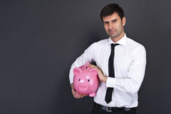 Young man with piggy bank Stock Image