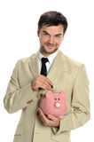 Young Man with Piggy Bank Royalty Free Stock Photos
