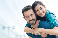 Young man piggyback her girlfriend Stock Photography