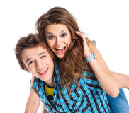 Young man piggybacking his girlfriend. Smiling young men piggybacking his pretty girlfriend. Isolated on white background Stock Image