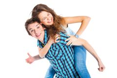 Young man piggybacking his girlfriend. Smiling young men piggybacking his pretty girlfriend. Isolated on white background Royalty Free Stock Photo