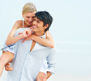 Young man piggybacking his girlfriend Stock Photography