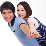 Young man piggybacking his pretty girlfriend. Young men piggybacking his pretty girlfriend isolated on white background Royalty Free Stock Photos