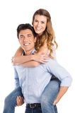 Young Man Piggybacking Woman Stock Images