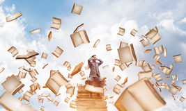 Young man on pile of books dont want to hear anything Royalty Free Stock Photo