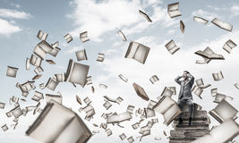 Young man on pile of books dont want to hear anything Stock Photos