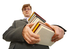 Young man with pile of books in hands Stock Images
