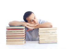 Young man with a pile of books sleaping Royalty Free Stock Image