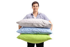 Young man with pillows Royalty Free Stock Photography