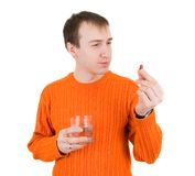 Young man with pills in hand Stock Images