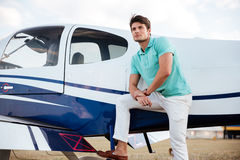 Young man pilot standing near small aircraft stock images