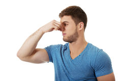 Young man pinching his nose. Stock Photos