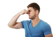 Young man pinching his nose. Stock Photos