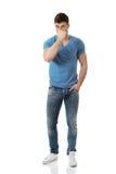 Young man pinching his nose. Royalty Free Stock Photo
