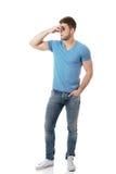 Young man pinching his nose. Stock Image