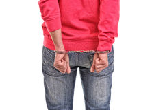 Young man with pink blouse handcuffed with hands behind his back Stock Photos