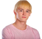 Young man in pink shirt Stock Images