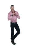 Young man in pink shirt Royalty Free Stock Photos