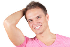 Young man in pink t-shirt Stock Photos