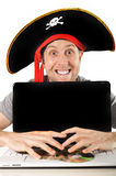 Young man in pirate costume and Computer Royalty Free Stock Photography