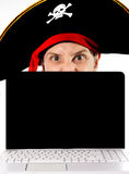 Young man in pirate costume and Computer Stock Photography