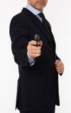 The young man with a pistol. The man in a suit aims from a pistol Stock Images