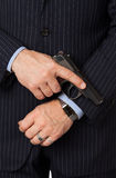 The young man with a pistol. The man in a suit aims from a pistol Royalty Free Stock Photo