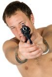The young man with a pistol. Isolated Stock Image