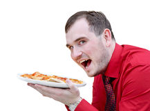 Young man with pizza Stock Photos