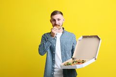 Young man with pizza royalty free stock photography