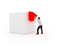 Young man placing a cube for completion Royalty Free Stock Photos