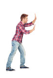 Young man with plaid shirt pushing Royalty Free Stock Photo