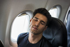 Young man in plane Royalty Free Stock Photos