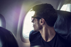 Young man in plane Royalty Free Stock Photo