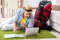 The young man planning his travel online. Young man planning his travel online royalty free stock photo