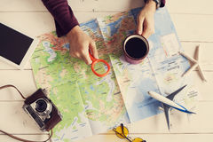 Young man planning travel vacation trip with map Stock Photo